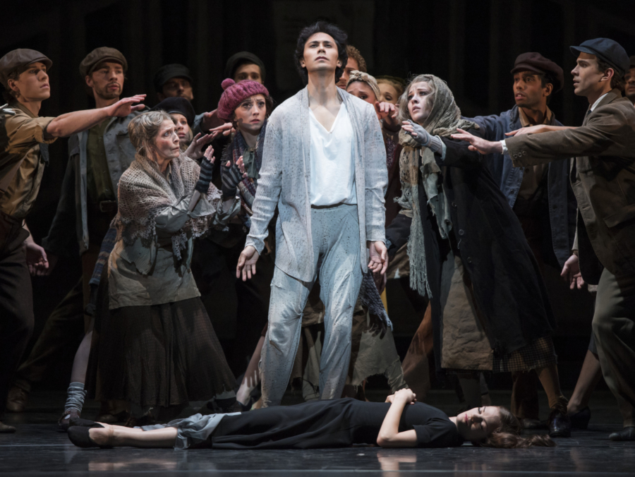 <p><em>Miracle in the Gorbals:</em> César Morales as the Stranger and Delia Mathews as the Suicide with Artists of Birmingham Royal Ballet</p>. Credit: Bill Cooper.
