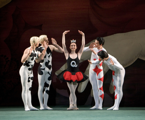 <p><em>Card Game: </em>Elisha Willis as the Queen of Hearts with Artists of Birmingham Royal Ballet</p>. Credit: Bill Cooper.