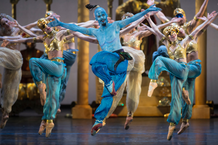 <p><em>Aladdin:</em> James Barton as the Djinn of the Lamp with Artists of Birmingham Royal Ballet</p>. Credit: Bill Cooper.