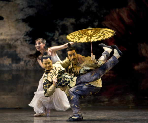 <p><em>The Nutcracker: </em>Christopher Larsen and Kit Holder in the 'Chinese Dance,' with Lei Zhao as Clara</p>. Credit: Bill Cooper.