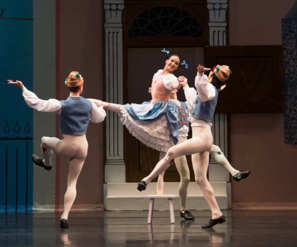 <p><em>Façade:</em> Arancha Baselga as the Milkmaid with Artists of Birmingham Royal Ballet in 'Yodelling'</p>. Credit: Bill Cooper.