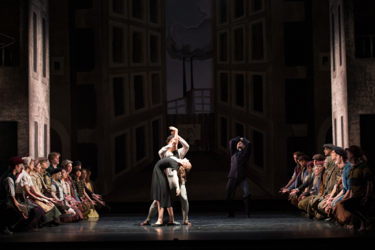 <p><em>Miracle in the Gorbals: </em>Delia Mathews as the Suicide and César Morales as the Stranger with Artists of Birmingham Royal Ballet</p>. Credit: Bill Cooper.
