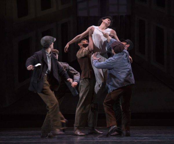 <p><em>Miracle in the Gorbals:</em> César Morales as the Stranger with Artists of Birmingham Royal Ballet</p>. Credit: Bill Cooper.