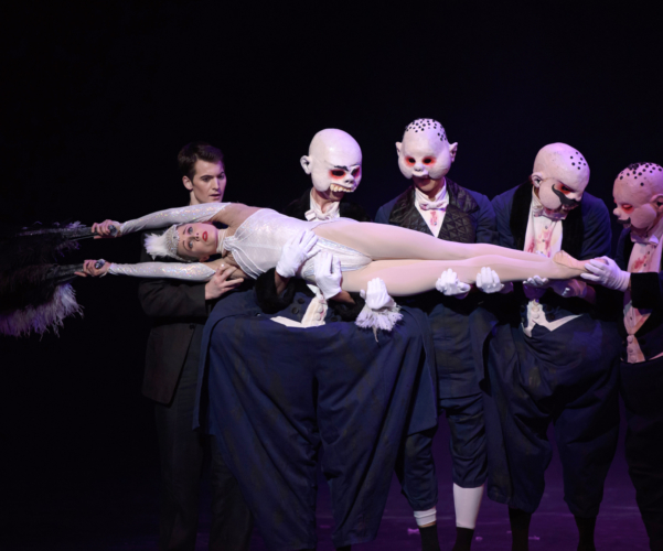 <p><em>Carmina burana: </em>Jenna Roberts as Roast Swan and Mathias Dingman as the Second Seminarian with Artists of Birmingham Royal Ballet as Gluttons</p>. Credit: Bill Cooper.