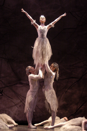<p><em>The Nutcracker: </em>Jenna Roberts as the Snow Fairy with Aaron Robison and Christopher Larsen as Winds</p>. Credit: Roy Smiljanic.