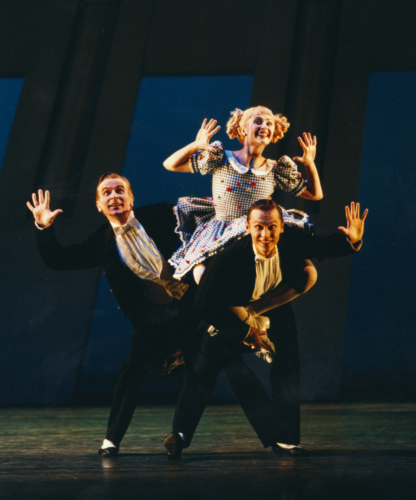 <p><em>The Nutcracker Sweeties:</em> Rachel Peppin as Buttons with Michael O'Hare and Timothy Cross as the Buttons Boys</p>. Credit: Bill Cooper.