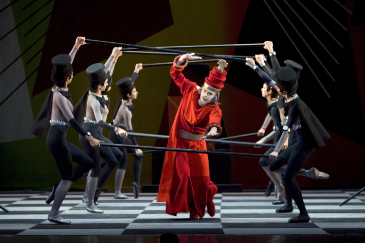 <p><em>Checkmate: </em>Jonathan Payn as the Red King with Artists of Birmingham Royal Ballet</p>. Credit: Bill Cooper.