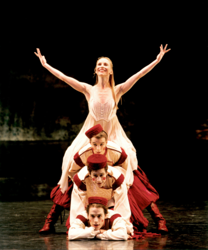 <p><em>The Nutcracker</em>: Carol-Anne Millar as Clara with Alexander Whitley, Kit Holder and Robert Gravenor in the 'Russian Dance'</p>. Credit: Bill Cooper.
