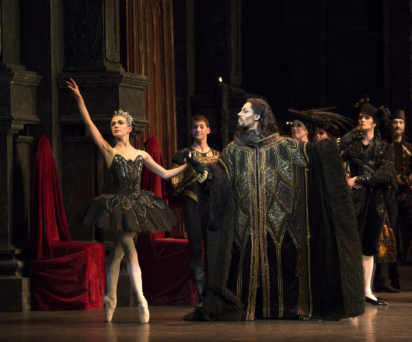 <p><em>Swan Lake: </em>Natasha Oughtred as Odile and Tyrone Singleton as Baron von Rothbart</p>. Credit: Bill Cooper.
