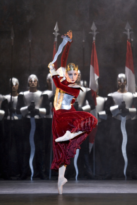 <p><em>Edward II: </em>Elisha Willis as Queen Isabella with Artists of Birmingham Royal Ballet</p>. Credit: Bill Cooper.