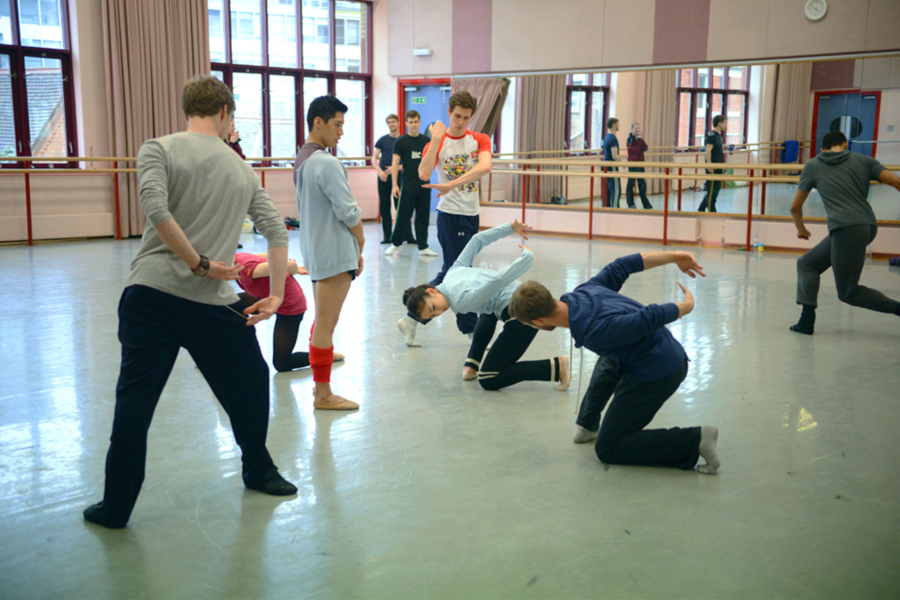 Choreographer Alexander Whitley teaches Kin. to members of the Company.